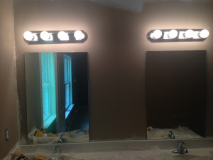 Master Bathroom with dual vanities and dual mirrors/lights.